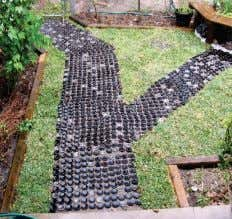 the construction of a pathway through the Brooklyn Centre Orchard Bottles used as construction material for