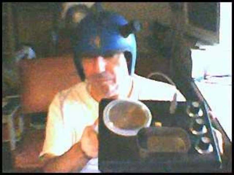 And here is a rather bad webcam shot of guess who with a helmet and