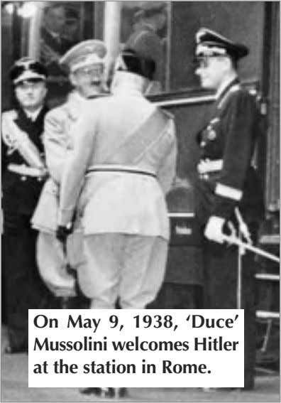 On May 9, 1938, 'Duce' Mussolini welcomes Hitler at the station in Rome.