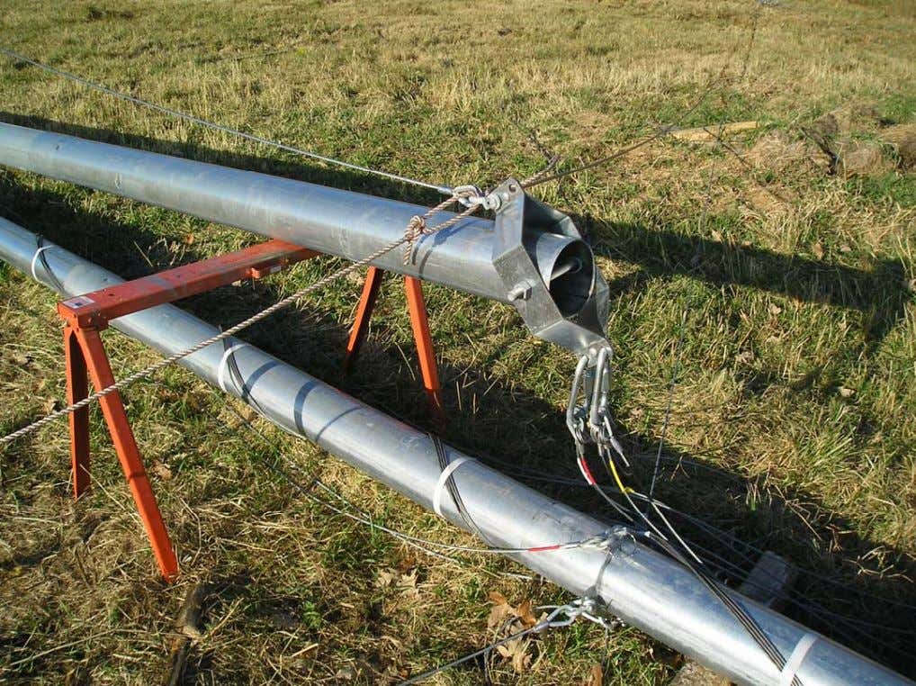 Attach the lifter wires Attach each of the four lifter wires to the ginpole using the