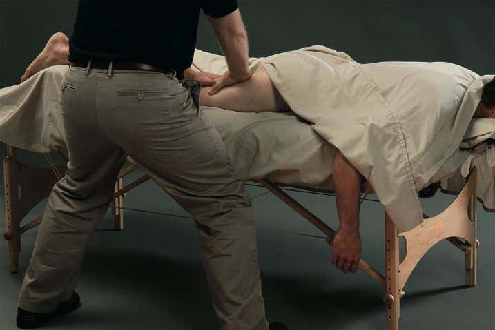 Figure 2-9 Performing the massage stroke in the horse stance. Bend knees to reach the