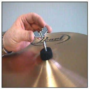 Slip the tilter post through the hole in the bell of the cymbal as shown