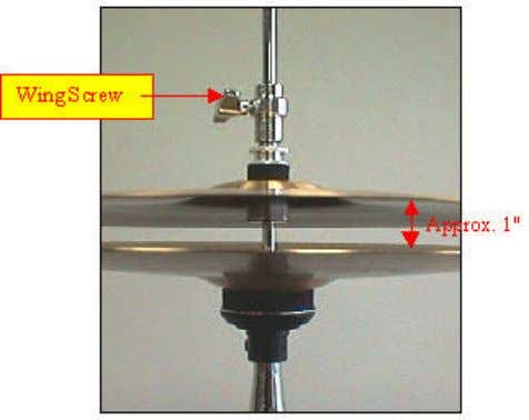 the clutch (with the top cymbal attached) onto the pull rod. Space the cymbals about an