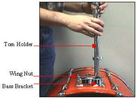 this setting. Step 5: Tom Holders: Attachment And Adjustment Secure the tom holders into the bass