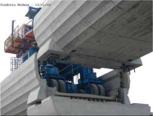 reinforcement and 24.8 kip (110 kN) of prestressing bars. Figure 11. Final lowering of the span.