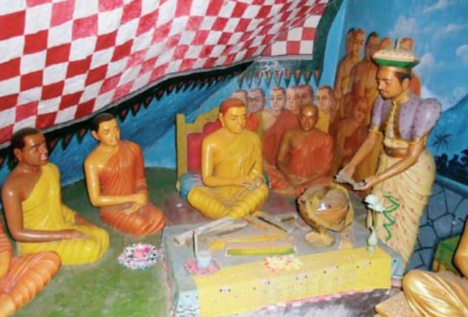a statue of buddhaghosha, the great buddhist commentator a scene of the Fourth buddhist Council