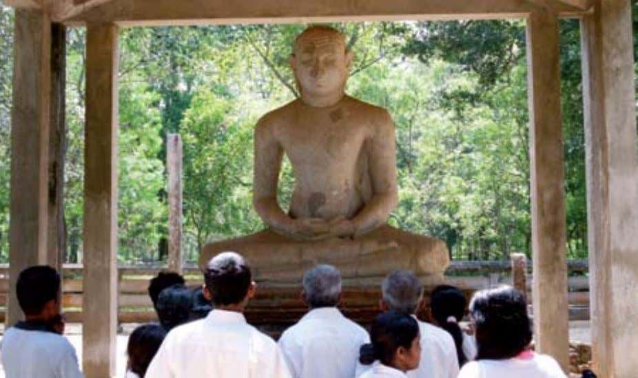 "called the ""Isurumuniya Lovers"". The abhayagiri undergoing restoration works admiring the samadhi buddha statue"