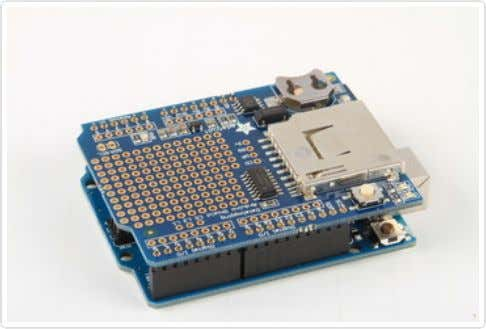 - long pins down - into the female headers on your Arduino. Position the shield: Align