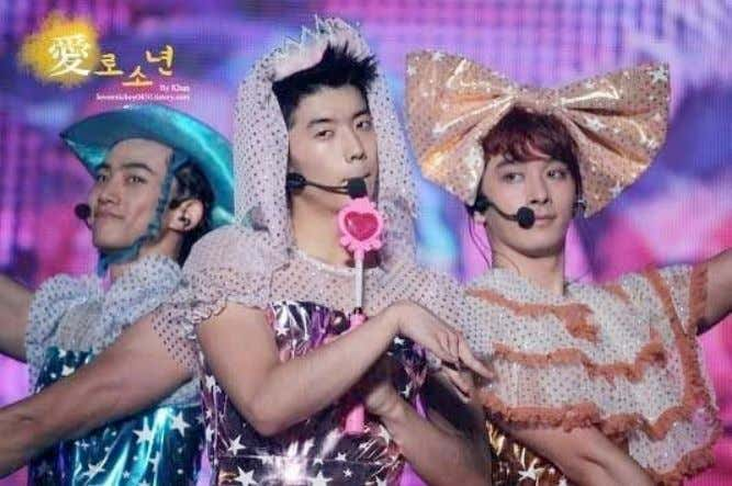 Picture 7: 2PM members Taecyeon, Chansung, and Wooyoung parodying girl group Orange Caramel at their