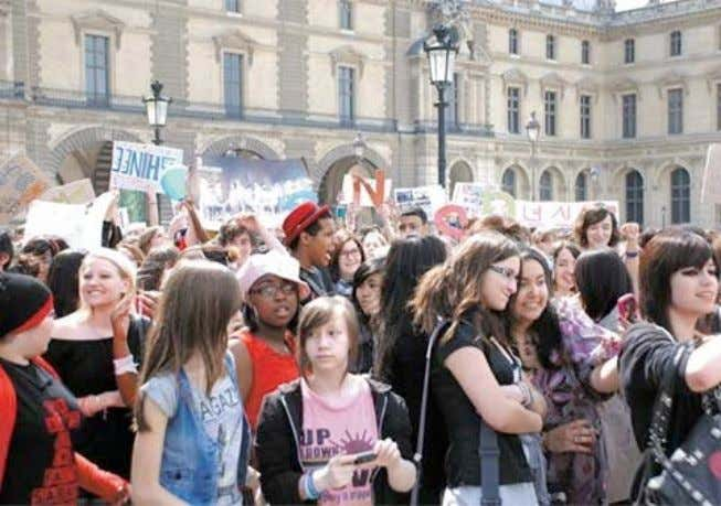 health department and concert security to contain the horde. Picture 2: Fans rally outside the Louvre