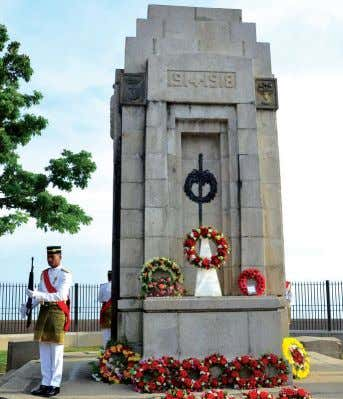 "or nationality, indicates our common stand for peace."" Wreaths laid in remembrance of those who perished"