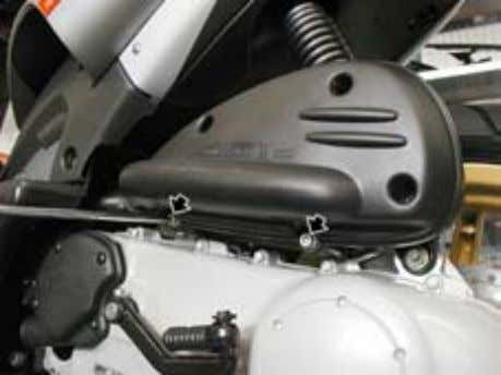 screws • Unscrew and remove the screw • Loosen the clamp on the carburettor. • Remove