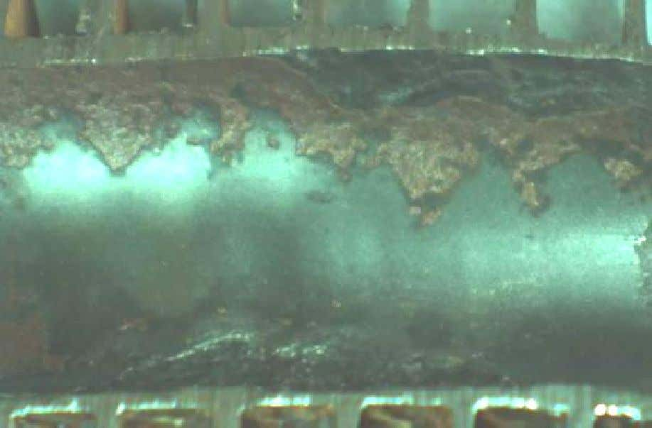 Close up view of copper corrosion products observed near gouged area of smooth finned tube.