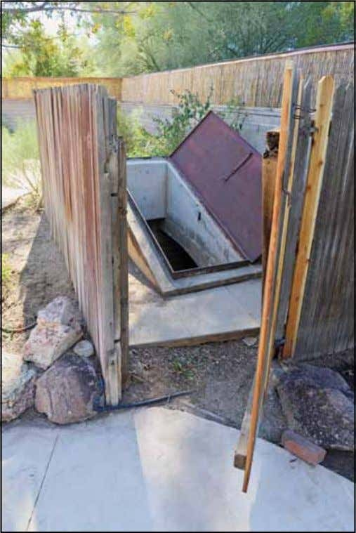 A steel door is the entrance hatch to a fallout shelter in my neighborhood. without