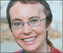 dozen others were hurt in the Jan. 8 attack in Tucson, Ariz. Congresswoman Gabrielle Giffords smiles