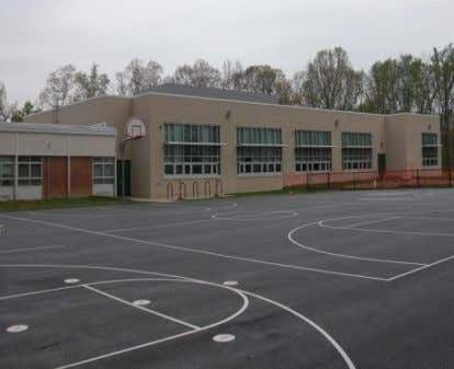 new playgrounds means that recess is more fun than ever. View of the new blacktop outside