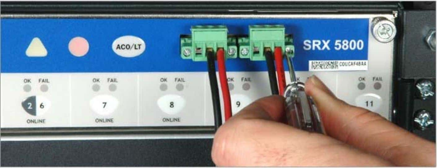 the SRX5800 Services Gateway to Management and Alarm Devices Connecting to an External Alarm-Reporting Device •