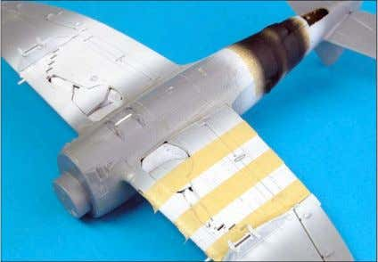 Masking and painting, step 1: the main paint job starts with the invasion stripes. First,