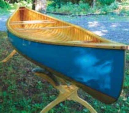 the hull shape and separates the top and bottom paint. E.M. White Specifications: Length ~ 14'