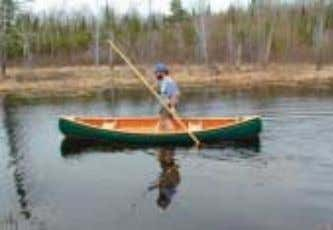 E.M. WHITE 14 FT . This 14 foot pack canoe was originally devel- oped by the