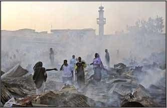 "they try again we will all die all together,"" warned Has- AP PHOTO Somali traders gather"