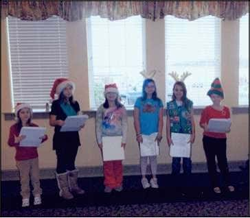 Sadie Bergstrasser, secretary; and Louise Clark, treasurer. Daisy Scouts sing carols at Tiffany Court Home Junior