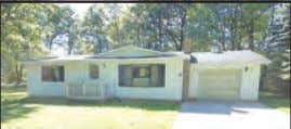 10661 W. Kelly, Lake City $65,000 Nicely wooded 4.6 acres are the setting for this