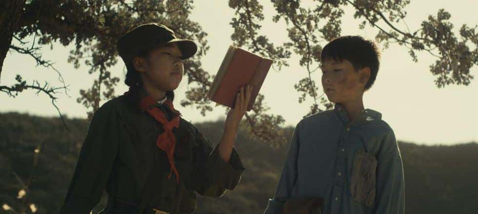 and frame grabs courtesy of the filmmakers. SHORT TAKES Hong (ViviAnn Yee) reads from Mao Zedong's