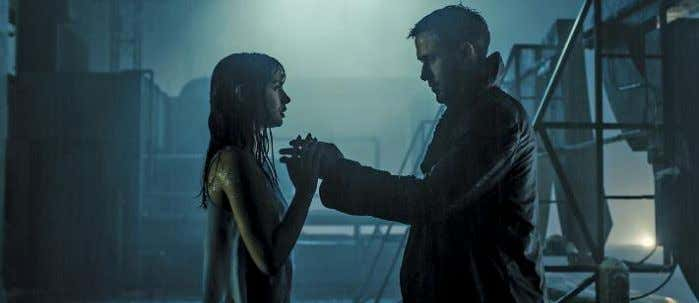 Joi (Ana de Armas) share a rooftop moment in the rain. liked the idea of L.A.