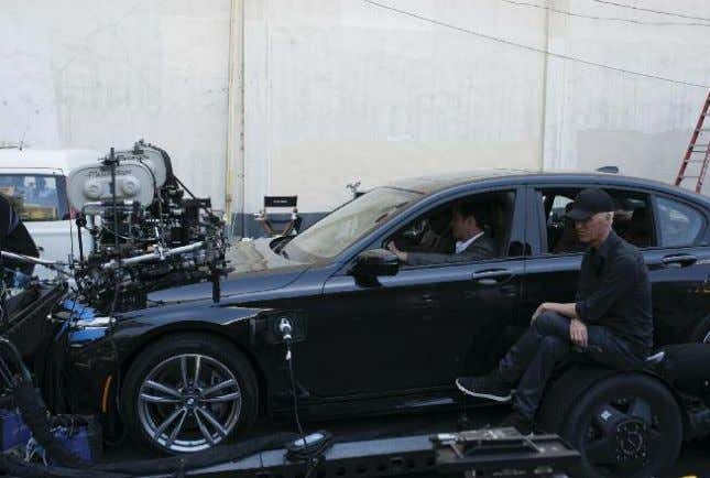◗ Strife and Justice Top: Gilroy sits beside a car while prepping a driving scene with