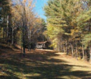 MOUNTAIN SIDE CAMP On 5 wooded acres offering distant views of Vermont's Green Mountains! Access