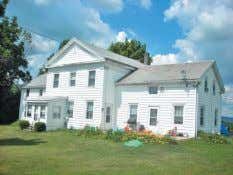 Hoosick. Early 1800's Greek Revival farmhouse w/in-law apartment & great views on 2 acres. Additional