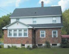 Petersburgh. 4-BR brick home on 20 acres near Little Hoosick trout stream, w/ patio, above