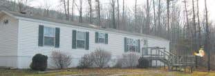 Immaculate mobile home on 1.12 acres. Country living with two decks, storage shed and many