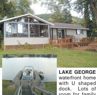 LAKE GEORGE waterfront home with U shaped dock. Lots of room for family and friends