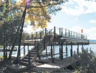 Southern Basin of LAKE GEORGE Enjoy this two bedroom tradi- tional camp or build your