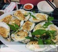 result of the overwhelming popularity of cheese in Vietnam. Baked Oysters with Cheese Vietnamese streetfood vendors