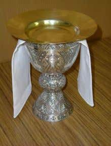 for the celebration of Mass. The paten rests on top of the purificator and the chalice