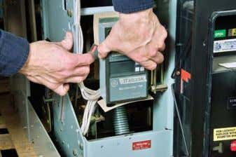 Push down on the lever. Figure 7: Removing the Old Trip Unit 5. If the breaker