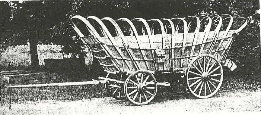 (Above and below.) Side and rear view of the large Burgner Conestoga wagon, said to