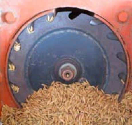 suitable for seeding into both tilled and nontilled soil. Inclined-plate (left) and fluted-roller (right) metering
