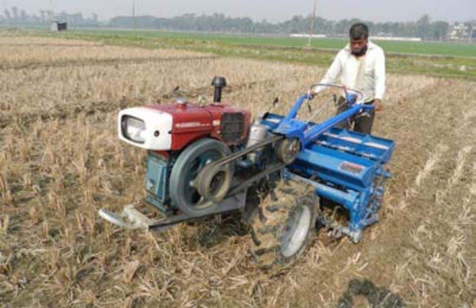 no fertilizer box, and a fluted-roller seeding mechanism. Crop being sown by a seed-cum-fertilizer drill with
