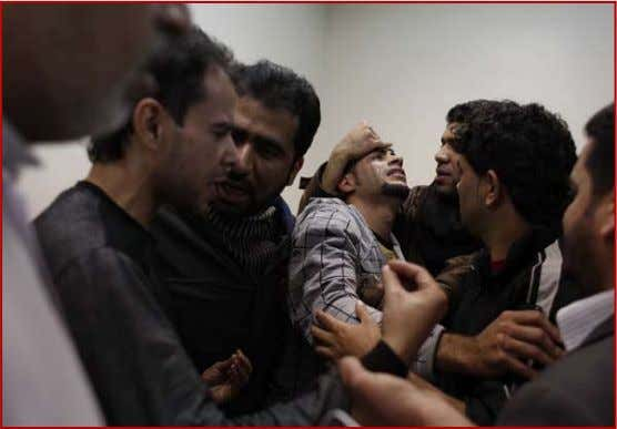 month were successful in overthrow- ing their president. A Bahraini man is comforted at a hospital