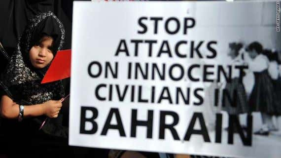 """Bahrain is flagrantly violating the most basic hu - An Indian child stands next to a"