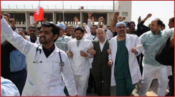 to the streets to demand democratic reforms were in Bahraine medics march outside a hospital in