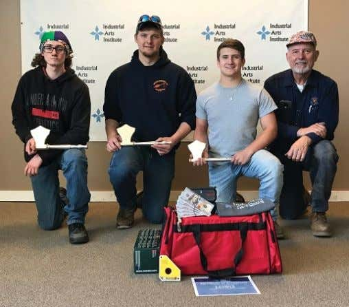 Earning 1 s t place at the Industrial Arts Institute's welding competition are (from left)