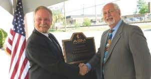 snpolytechnic.com . ASM International Honors Weld Mold Fred Schmidt (right), president, ASM International, presents
