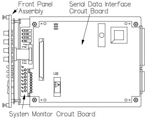 board by gently prying it away from the two mating connectors and 4 standoffs on the