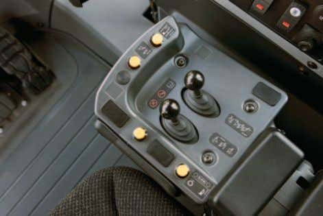 can change systems as required. Implement Controls (EH) Seat mounted single axis implement control levers provide