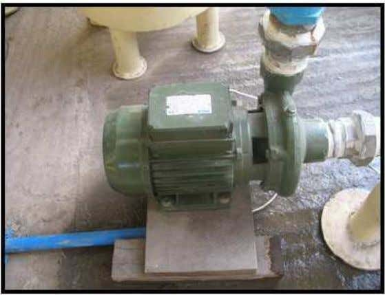 the water in the cleaning and cooling system. The water pump (1 HP) is shown in
